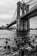 Fototapeta Mosty View of Brooklyn Bridge from below in black and white