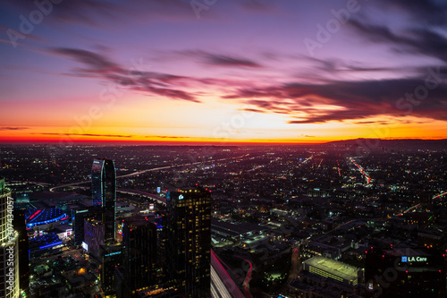 Dusk settles in over the city of Los Angeles, with streaking skies and hazy background