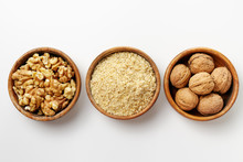 Whole Walnuts, Walnut Kernel And Ground Walnuts In Wooden Bowls .