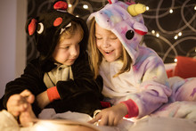 Kids Reading Christmas Fairy Tales In Bed