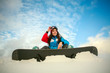 Young woman in winter mountains with snowboard, extreme sports.leisure activities
