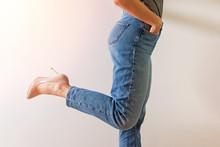 Woman Dressed In Denim Pants A...