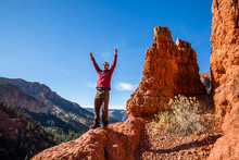 Excited Man Celebrating Hiking In The Red Rock Formations Of Southern Utah.