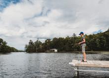 Boy Fishing With A Fishing Rod...