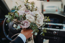 Groom Carries A Bouquet To The...