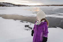 Little Girl Plays On Frozen Lake