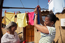 Woman Hanging Clothes On Washing Line