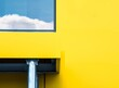 canvas print picture - Black machine under the window with the view of white clouds on a yellow background