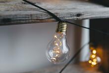 Light Bulbs And Wooden Shelf