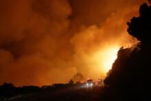Firefighters Battle A Blaze In...
