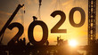 Silhouette construction site,Cranes building construction 2020 year sign