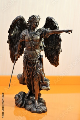 Photo bronze sculpture of Archangel Michael with wings and sword