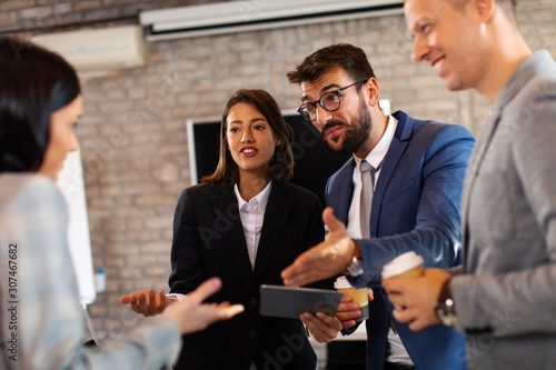 Group of young business people communicate in the office Wallpaper Mural
