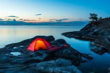 Tent And Kayak On Rocks