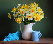 White And Yellow Daffodils In A Jug.