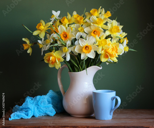 Fényképezés white and yellow daffodils in a jug.