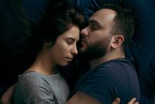 Close Up Of Couple Sleeping On...