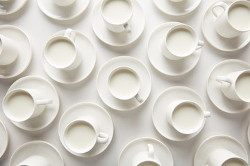 Layout of white cups with milk