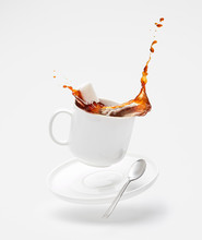 Falling Cup With Splashing Cof...