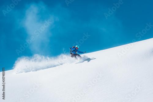Snowboarder riding his board