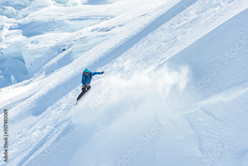 Snowboarder riding on the glacier