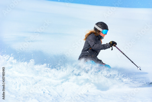 Woman skiing on fresh snow