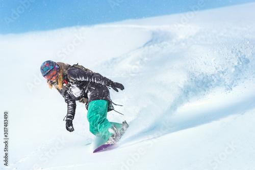 Closeup of a female snowboarder