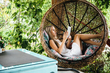 Woman Resting In Rocking Chair