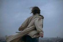 Rear View Of Woman In Coat Sta...