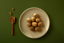 Overhead View Of Walnuts On Ceramic Plate