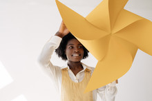 Smiling Black Woman Spinning Pinwheel