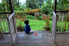 Little Girl Sitting On The Por...