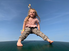 Portrait Of Girl Jumping In Air