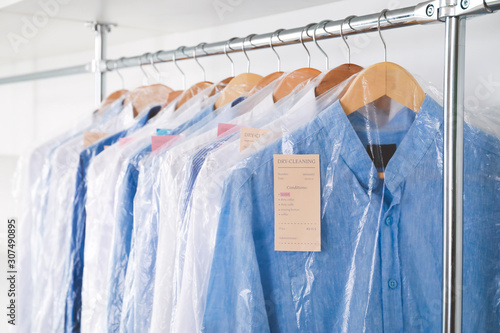 Rack with clothes in modern dry-cleaner's Poster Mural XXL