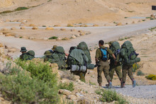 Squad Of Israeli Elite Unit.  Soldiers Training In The Desert. Israeli Army Combat Soldiers Return To Base After Completing Military Mission.