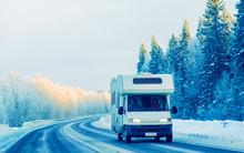 Mini Van On Winter Road With S...