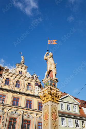 Foto op Plexiglas Historisch mon. Low angle view of Roland Statue and Renaissance building against blue sky in Erfurt, Germany