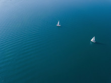 Germany, Bavaria, Aerial View Of?two Sailboats Sailing Across Blue Waters Of?Chiemsee?lake