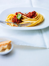 Macaroni With Bolognese Sauce In Plate On Table
