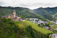 Aerial View Of Castle On Mountain Against Cloudy Sky In Town, Cochem, Germany