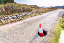 Traffic Cone In Pot Hole On Road At Isle Of Skye, Highlands, Scotland, UK