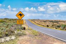 Kangaroo Crossing Sign By Great Ocean Road Against Sky, Victoria, Australia