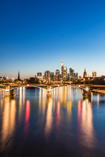 Illuminated Ignatz Bubis Bridge Over River Main Against Blue Sky During Sunset, Frankfurt, Germany
