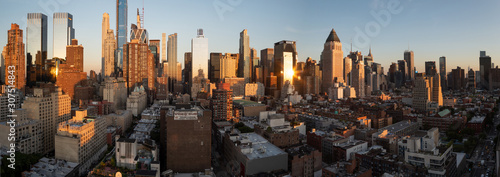Fototapeta Sunset panorama of Manhattan's Hell's Kitchen skyline as seen from the 10th Avenue, Midtown Manhattan, New York City. Taken on September the 25th, 2019. obraz