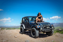 Woman With A Jeep In The Arizo...