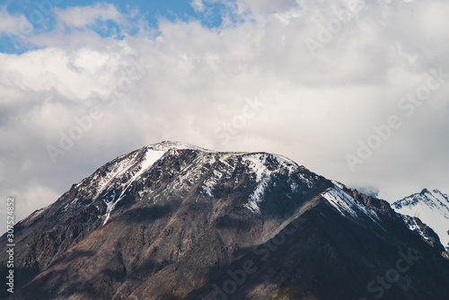 Fotografie, Obraz  Atmospheric alpine landscape to snowy mountain ridge in sunny day