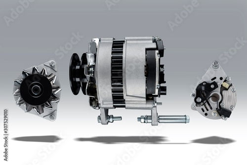 Photo Alternator for agricultural machinery like tractor or combine-harvester placed on gray isolated background with shadow