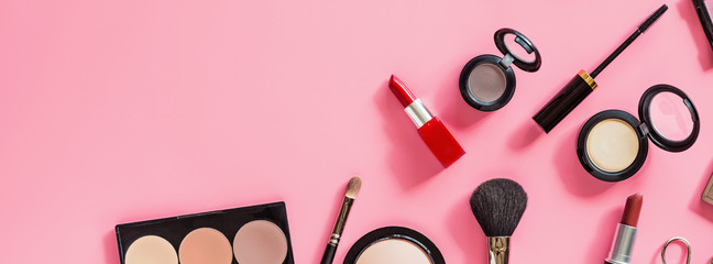 Make up items on pink color background. Horizontal web banner. Set of luxury ...