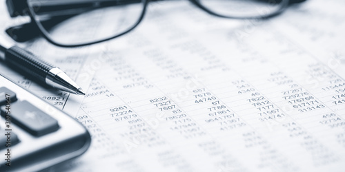 Photo Close-up Pen Calculator And Reading Glasses On Financial Report - Business Accou