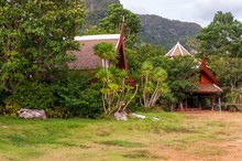 Low Angle Shot Of A House In The Middle Of Green Scenery In Ao Nang Krabi, Thailand, Asia